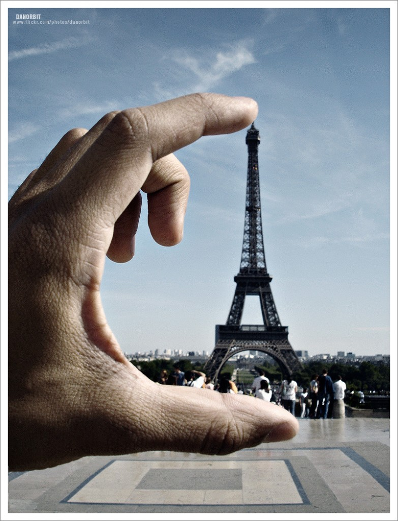 One hand holding Eiffel Tower